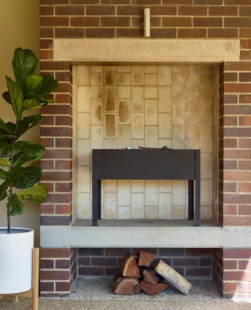 Outdoor fireplace, built by Brisbane custom-home builder Bluebird